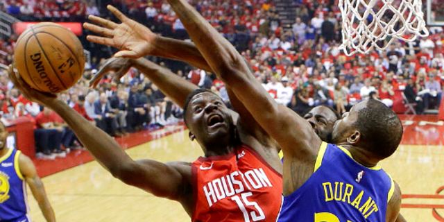 Houston Rockets center Clint Capela (15) shoots as Golden State Warriors forward Kevin Durant (35) defends during the first half of Game 4 of a second-round NBA basketball playoff series.