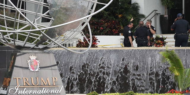 Sunny Isles Beach police officers work near the entrance to the Trump International Beach Resort as they investigate a shooting that reports say involved rapper NBA Youngboy on the street in front of the resort on Sunday. Police continue to investigate the scene.