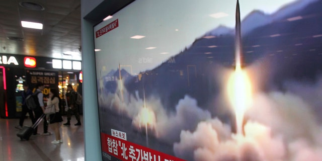 A TV screen shows a file footage of North Korea's missile launch during a news program at the Seoul Railway Station in Seoul, South Korea, Saturday, May 4, 2019.