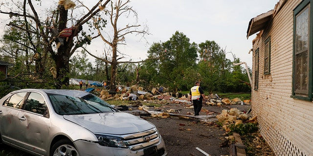 Storm damage litters a residential neighborhood, Tuesday, May 28, 2019, in Vandalia, Ohio.