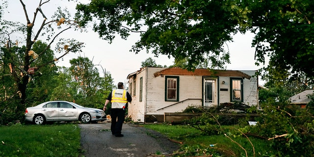 Storm damage litters a residential neighborhood, Tuesday, May 28, 2019, in Dayton, Ohio.
