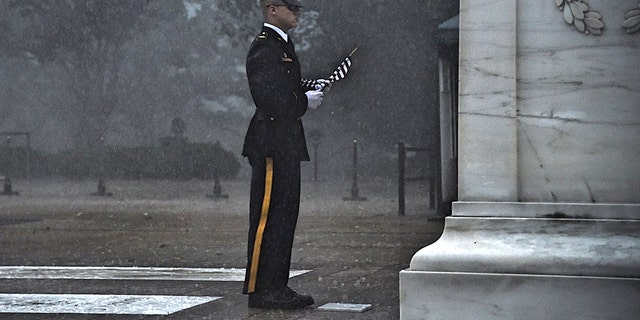 A severe thunderstorm Thursday failed to stop a sentinel from placing a flag at the Tomb of the Unknown Soldier.