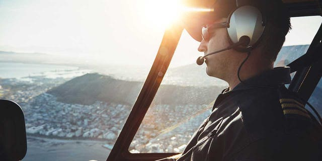 A stock image of a pilot flying a plane.