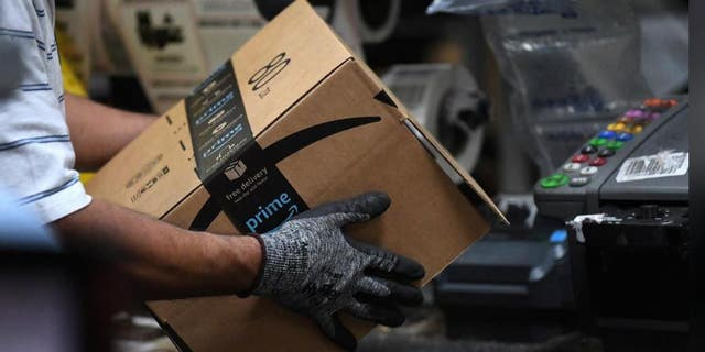 A worker assembles a box for delivery at the Amazon fulfillment center in Baltimore, Maryland, U.S., April 30, 2019.