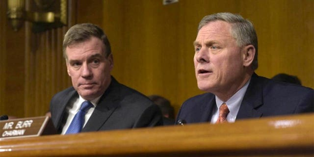 Senate Intelligence Committee Chairman. Sen. Richard Burr, R-N.C., right, joined by Vice Chairman Sen. Mark Warner, D-Va., left, at a Senate Intelligence Committee hearing on Capitol Hill in Washington, Thursday, March 30, 2017. (AP Photo/Susan Walsh) (The Associated Press)