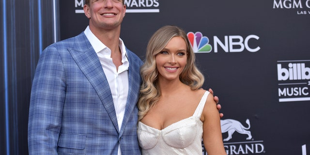 Rob Gronkowski and Camille Kostek arrive at the Billboard Music Awards on May 1, 2019, at the MGM Grand Garden Arena in Las Vegas.