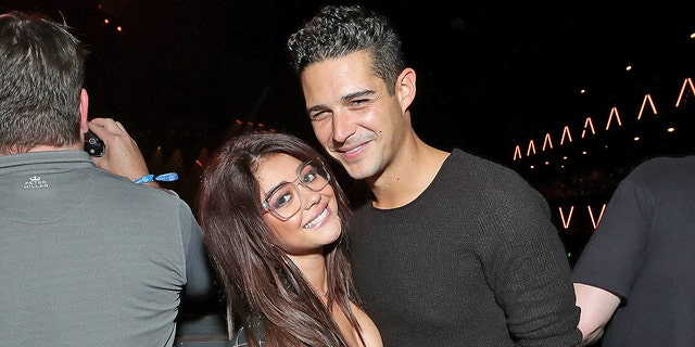 Sarah Hyland and Wells Adams are madly in love, but he says their parents will only meet at their eventual wedding. Adams claims that his conservative parents likely won't get along with Hyland's more liberal brood.