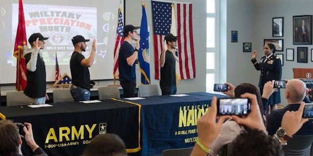 "Four students at Becton Regional High School in New Jersey signed their intent to join the armed forces at the school's first ""military signing day."""