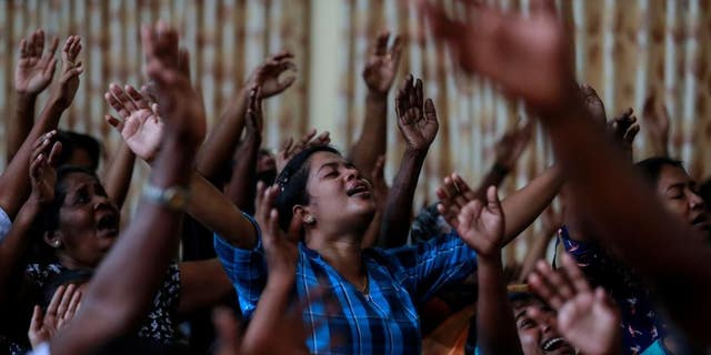 Zion Church members pray at a community hall in Batticaloa, Sri Lanka, May 5, 2019. Their church was bombed on Easter Sunday.
