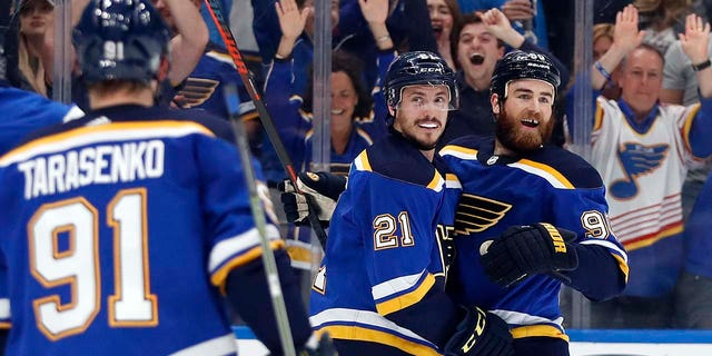 St. Louis Blues center Tyler Bozak (21) celebrates with Vladimir Tarasenko (91), of Russia, and Ryan O'Reilly (90) after Bozak scored a goal against the San Jose Sharks during the first period in Game 4 of the NHL hockey Stanley Cup Western Conference final series Friday, May 17, 2019, in St. Louis.
