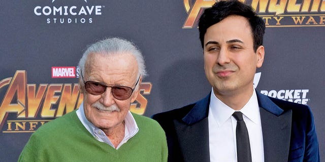 "Marvel creator Stan Lee poses with former business manager Keya Morgan at the ""Avengers: Infinity War"" premiere in Los Angeles in April 2018."