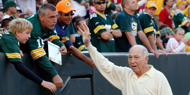 In this Sept. 10, 2012, record photo, former Green Bay Packers quarterback Bart Starr waves to fans during a Packers' NFL football diversion opposite a San Francisco 49ers in Green Bay, Wis.