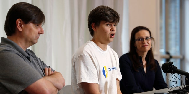 Joshua Jones, center, who was wounded while trying to stop a gunman involved in the attack on the STEM School Highlands Ranch last week, speaks during a news conference as his father, David, left, and mother, Lorie, listen.