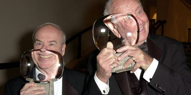 Tim Conway, left, and Harvey Korman hold up their awards. (Photo by M. Caulfield/WireImage)