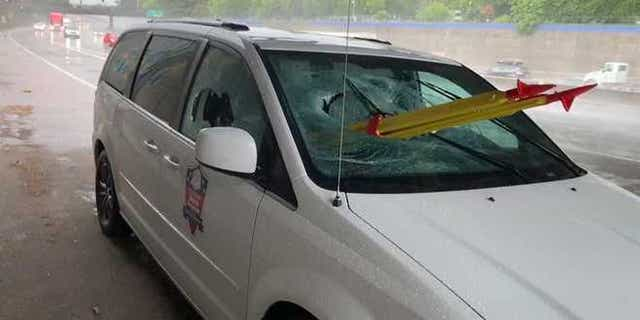 A stolen tripod smashed through the glass of a van last Thursday, injuring the passenger, authorities said.