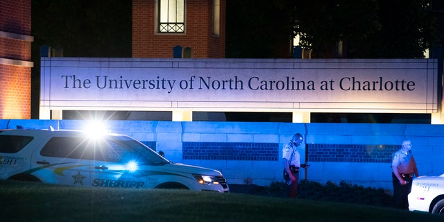 Police secure the main entrance to UNC Charlotte after a shooting at the school that left two students dead, Tuesday, April 30, 2019, in Charlotte, N.C.
