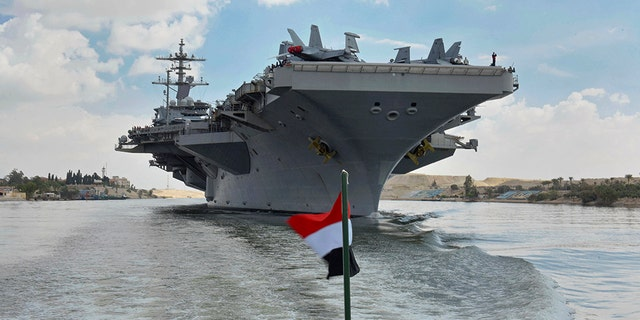 The USS Abraham Lincoln sails south in the Suez canal near Ismailia, Thursday, May 9, 2019.
