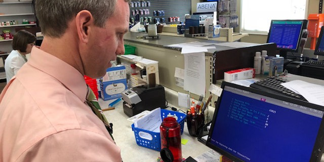 Cole Sandlin works to fill a prescription for a customer in Hamilton, Alabama where high speed internet is recently emergeing. (Fox News/Charles Watson)