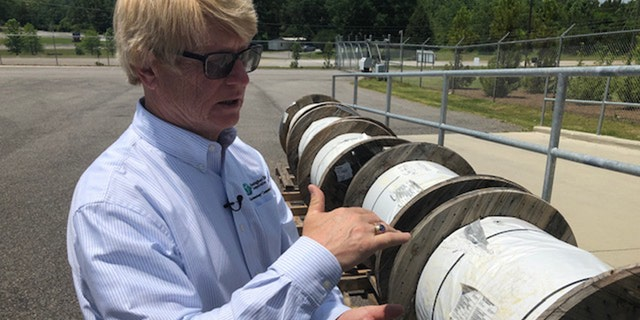 Steve Foshee, Ceo of Tombigbee, shows of a fiber ocular reels a co-ops auxiliary will run in northwest Alabama. (Fox News/Charles Watson)