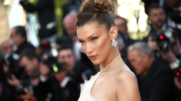 Bella Hadid goes topless in a thong and $620 Burberry towel