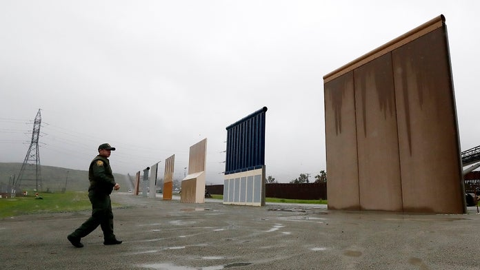 Judge temporarily blocks Trump border wall construction plans