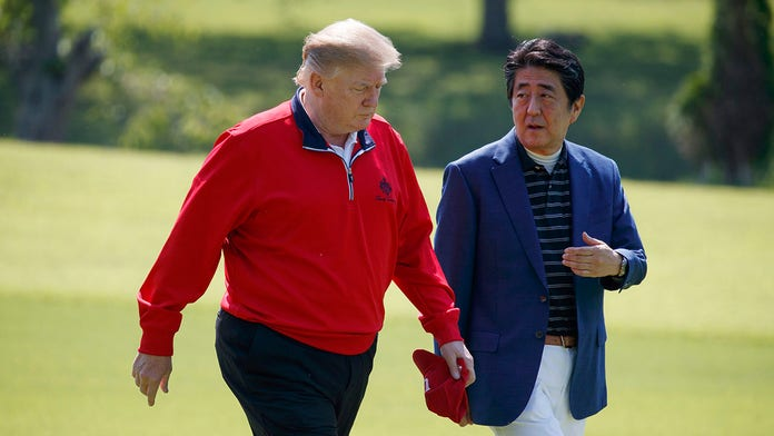 Trump, Japan's PM bond on golf course during state visit