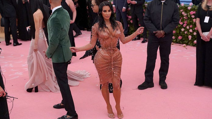Kim Kardashian West says curve-hugging Met Gala gown wouldn't allow her to sit -- or use restroom