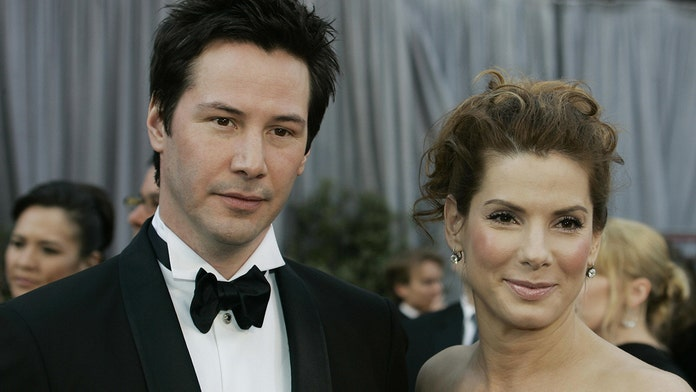 Sandra Bullock won't fix Keanu Reeves up on a date: 'He's good'