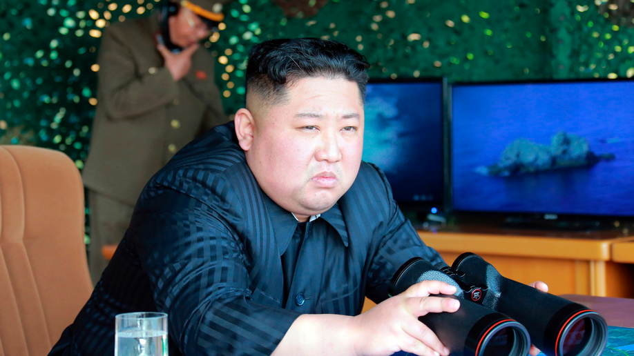 N Korea says it fired long-range missiles under 'command' of Kim Jong