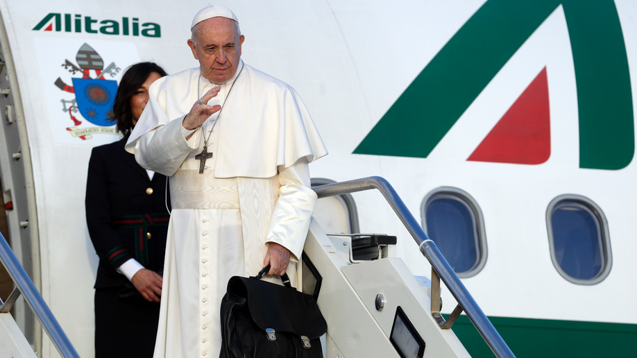 Pope to refugees: You bear cross of humanity