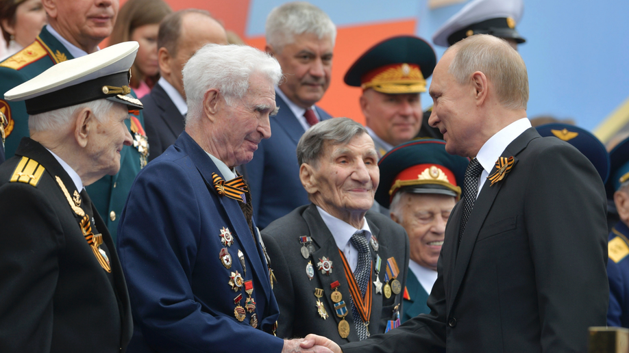 On anniversary of Nazi defeat, Putin vows to strengthen Russian military