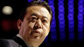 China says Interpol ex-president confesses to bribe taking, wife suspects an imposter