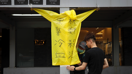 The Latest: Hong Kong activists urge public to hold strike