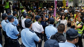 Hong Kong police face off with protesters while trying to clear streets