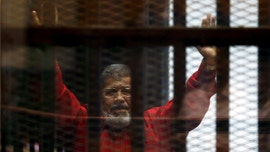 Egypt's ousted President Mohammed Morsi dead after collapsing in court