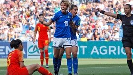 Italy beats China 2-0, reaches first quarterfinal since 1991