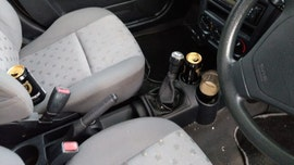 Drunk driver caught with pint glass of beer in cup holder