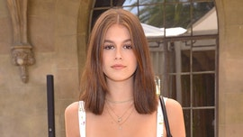 Kaia Gerber shares topless photo to show off new ink following brother's face tattoo backlash