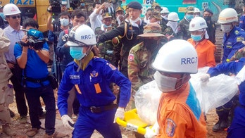 Cambodia building collapse: 2 people found alive in rubble; at least 28 dead