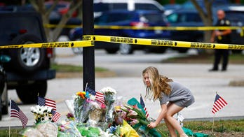 Virginia Beach shooter's kin offer condolences in note taped up outside home