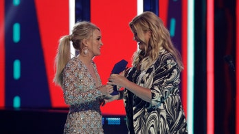 Carrie Underwood jokes her CMT Music Awards win is Mike Fisher's birthday present: 'Look what they got you'