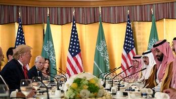Trump praises Saudi crown prince as a 'friend,' declines say if he will discuss Khashoggi
