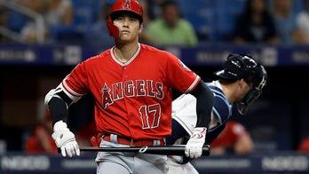 Fan snags foul ball off bat of Angels' Shohei Ohtani, gives it to Ohtani fan