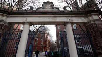 Harvard University custodian with coronavirus-like symptoms accuses school of neglecting her