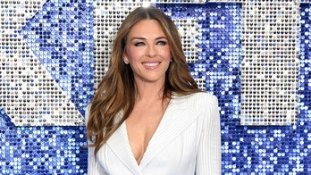 Elizabeth Hurley, 54, bids farewell to summer in plunging red bikini and Daisy Duke shorts