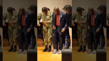Father's Day made: Dancing pastor falls over when Navy daughter surprises him at church