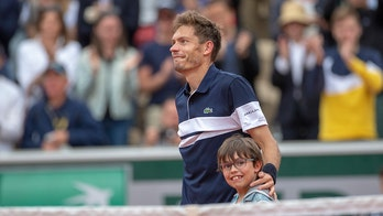 French tennis star Nicolas Mahut shares heartwarming moment with son on court after French Open loss