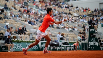Djokovic aims to extend Slam streak at French Open