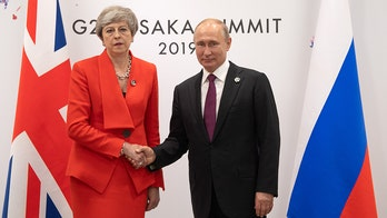 Theresa May offers Putin icy hand-shake at G20 summit in first meeting since Salisbury nerve agent attack