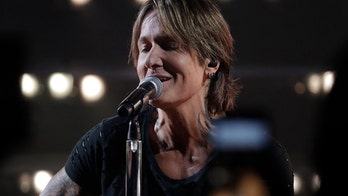 Keith Urban attends CMT Music Awards without wife Nicole Kidman: 'Baby girl, I miss you'
